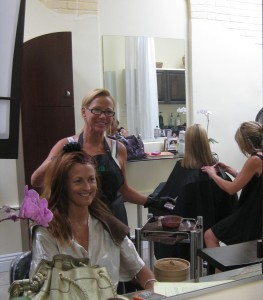 Susan touches up a regular client's vibrant red