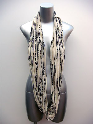 The Necklush shown in creamy with black print. Made from organic cotton.