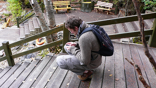 man relaxing in a squat