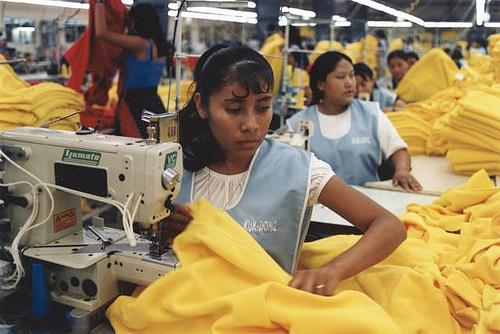 sweatshop labor - women working in a garment factory