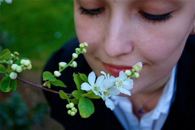 Girl Smelling Flower by Dimacius at Flickr.com, Creative Commons