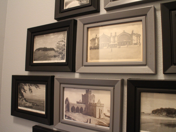 For a unique conversation starter, make a gallery wall of postcards