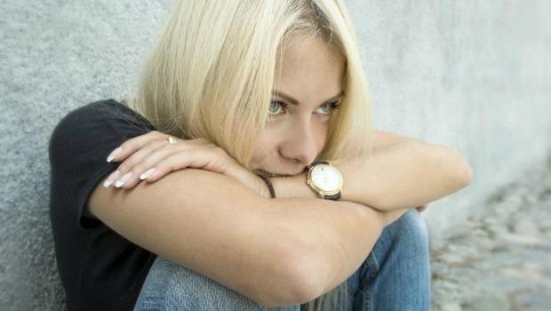 Woman sitting still via Shutterstock