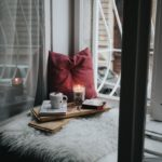 candles and tea next to window